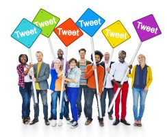 Group of Multiethnic People Holding Sign Poles with the Word Tweet