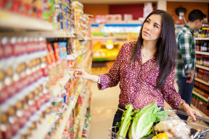 Latina Buying food at the supermarket Latino economic power