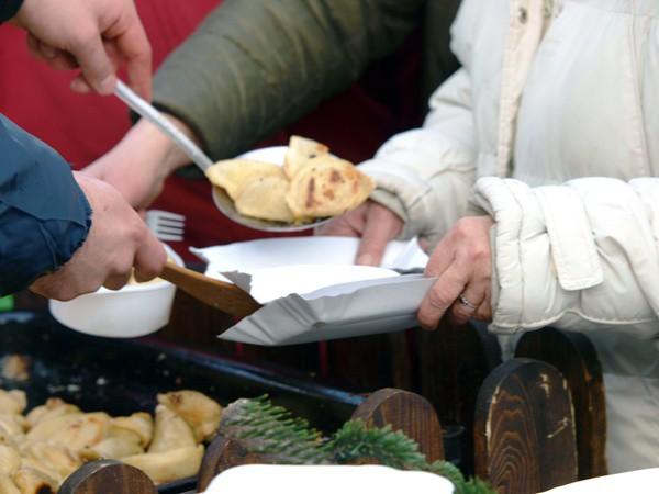 Poor people receiving food instead of economic empowerment