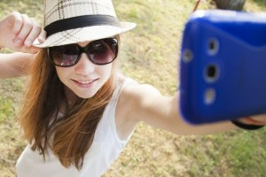 girl taking photos with her phone