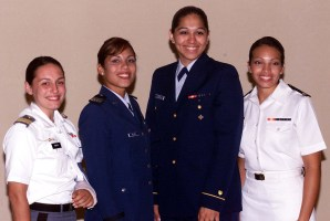 Midshipman First Class Maia Molina-Schaefer, far right, is the first woman in Naval Academy history to compete in and win the annual brigade boxing championship. Also pictured from the left, are Cadet First Class Jessica C. Tomazic, U.S. Military Academy; Cadet First Class Cindy Nieves, U.S. Air Force Academy; and Cadet First Class Lily Zepeda, U.S. Coast Guard Academy. Photo by Rudi Williams