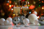 Two champagne glasses and christmas balls