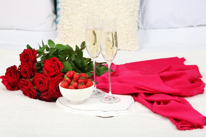 Romantic still life with champagne, strawberry and roses for Latina business woman