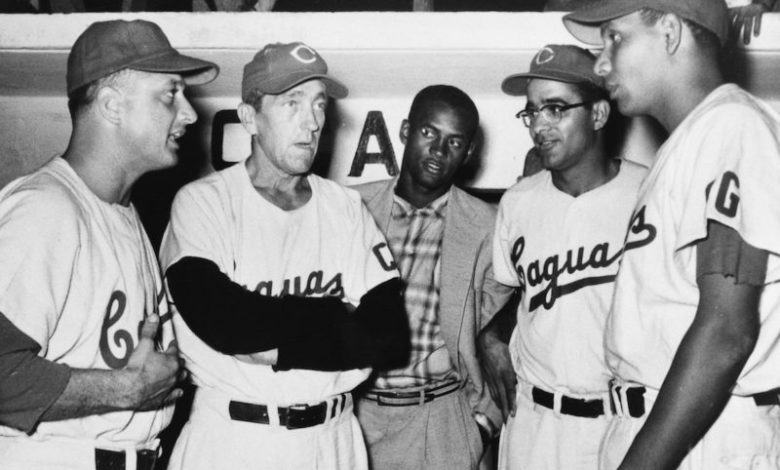 Roberto Clemente (c.) listens as Caguas manager Ben Geraghty (2nd from l.) strategizes with his pitching staff (l. to r.): Tommy Lasorda, Roberto Vargas and Chi Chi Olivo.