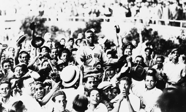 Pitcher Roy Partlow of the San Juan Senadores is carried off the field by a jubilant crowd in 1939 after defeating the great Satchel Paige, pitching for the Guyana Brujos.