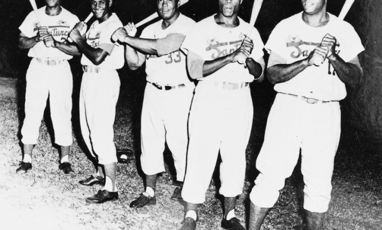 Willie Mays, 21-year-old Roberto Clemente, Buster Clarkson, Bob Thurman and George Crowe (l. to r.) were the Murderers' Row of the Santurce team that won the 1955 Caribbean Series championship in Venezuela.