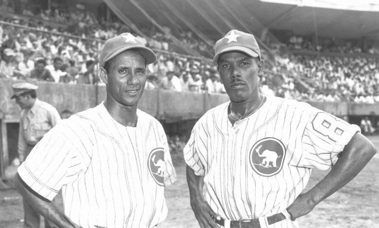 Estrellas Orientales shortstop Papito Vargas and infielder Coco Ferrer of Puerto Rico in 1951.