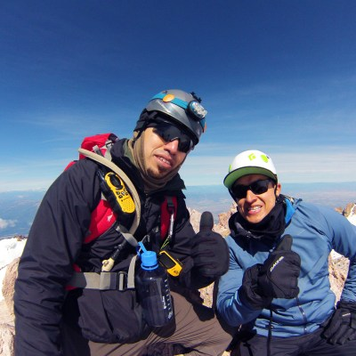 Taking a break at the summit of Mount Shasta t with my friend Arnaldo. It took us close to 11 hours to reach the summit through Avalanche Gulch.