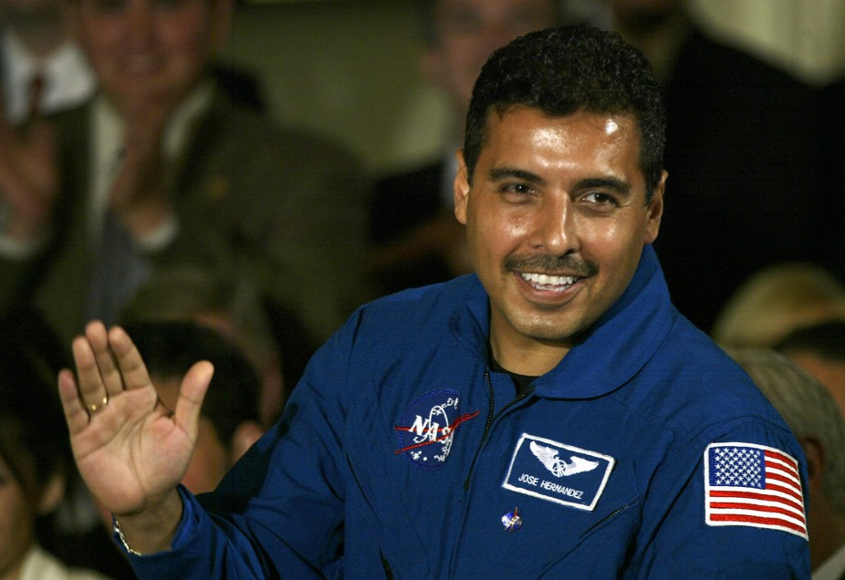 Mexican astronaut Jose Hernandez waves t