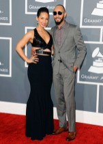Alicia Keys and Swizz Beatz arrive to the 2013 Grammys Red Carpet [Photo: Getty Images]