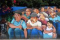 mural of mexican men and women crouched down and looking over their shoulder
