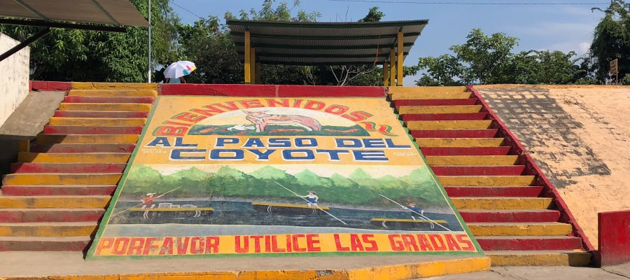 sign welcoming migrants to Paso del Coyote informal border crossing between Mexico and Guatemala