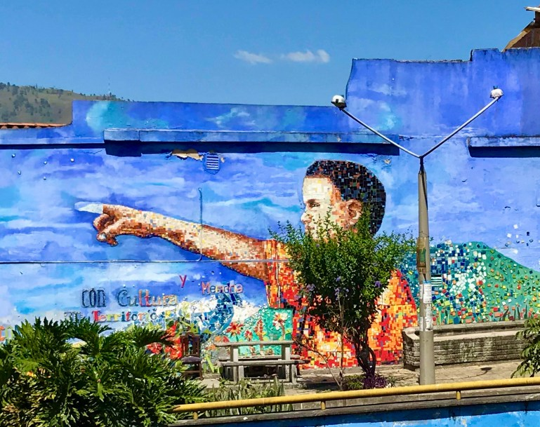 Mural of boy pointing in Moravia, Medellin