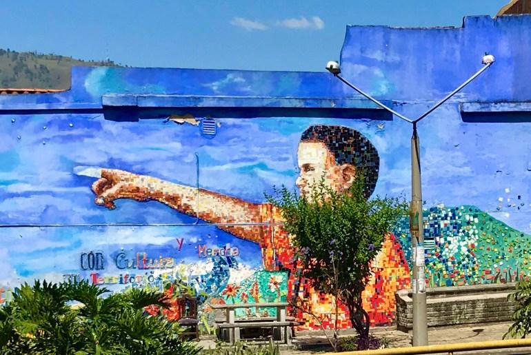 Mural of boy pointing in Moravia, Medellin