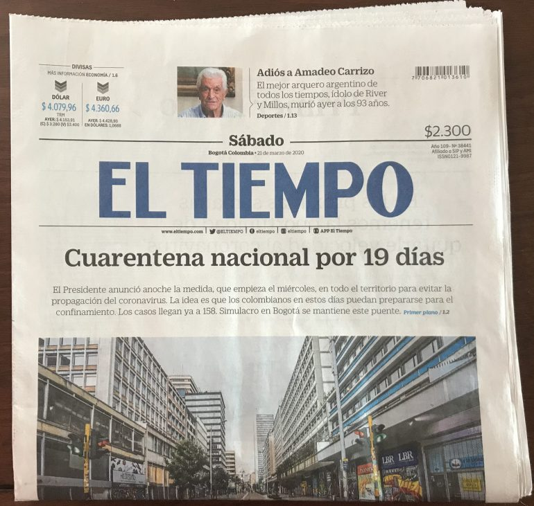 newspaper out of Bogota Colombia with headline about Colobmia COVID-19 quarantine