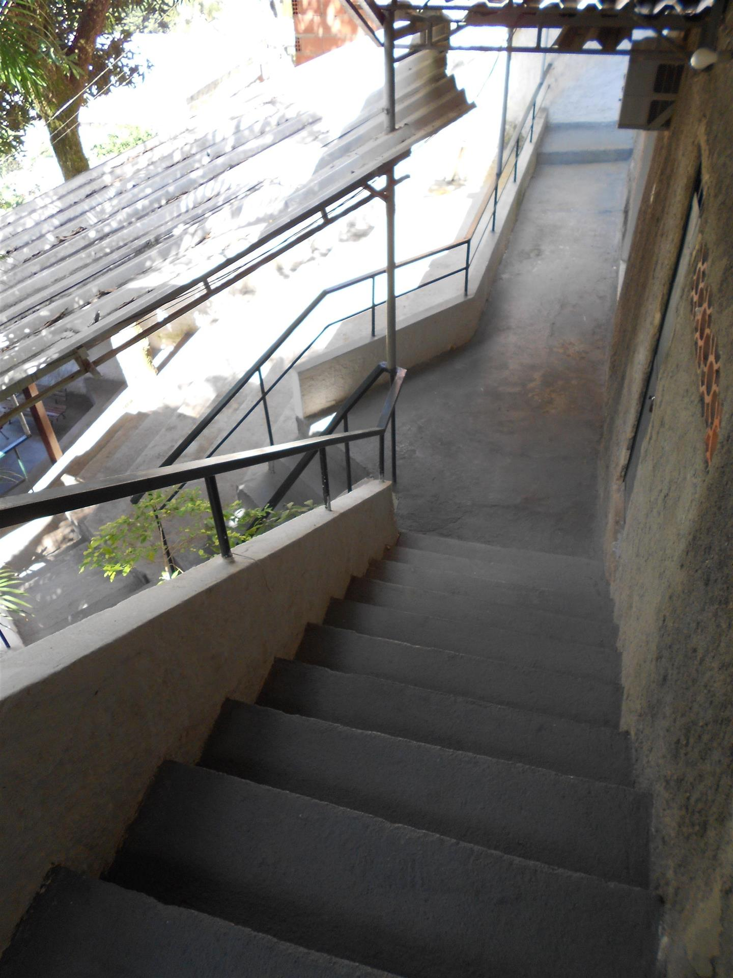 Stairs down to more rooms