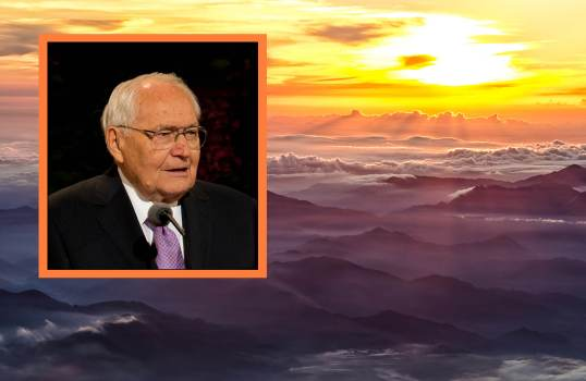Picture of L. Tom Perry on a background with a sunset