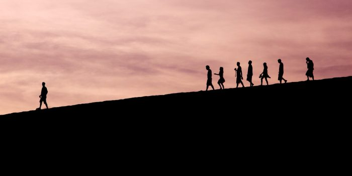 Silhouette of people on hill photo.