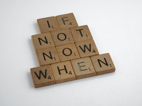 """Twelve scrabble game squares that spell out, """"If not now, when."""""""