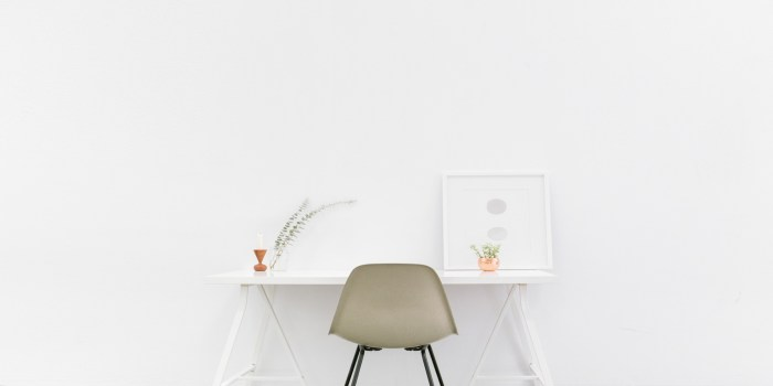 A desk on a white wall.
