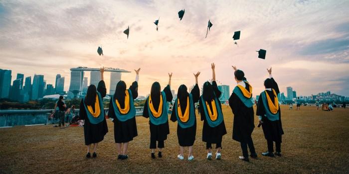 Friends Throwing Graduation Caps
