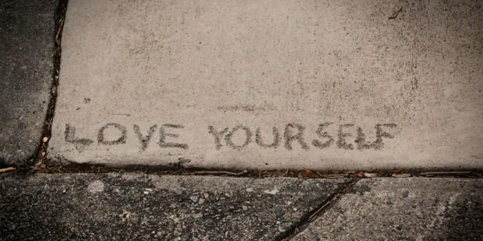 """Love Yourself"" written in concrete."