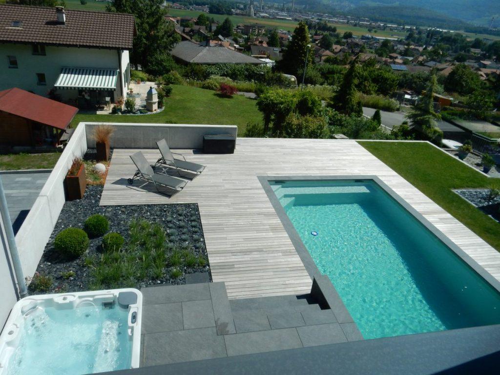 Aménagement complet par un paysagiste du Valais avec piscine béton armé avec liner et spa