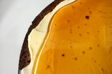 Amber honey on black bread with butter