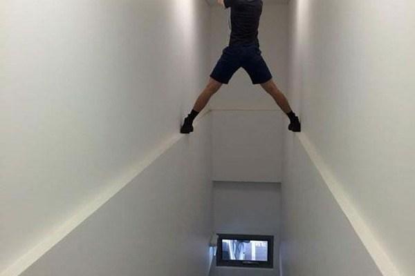 Ethan Hunt changes a lightbulb