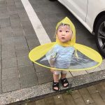 Cute kid in umbrella coat