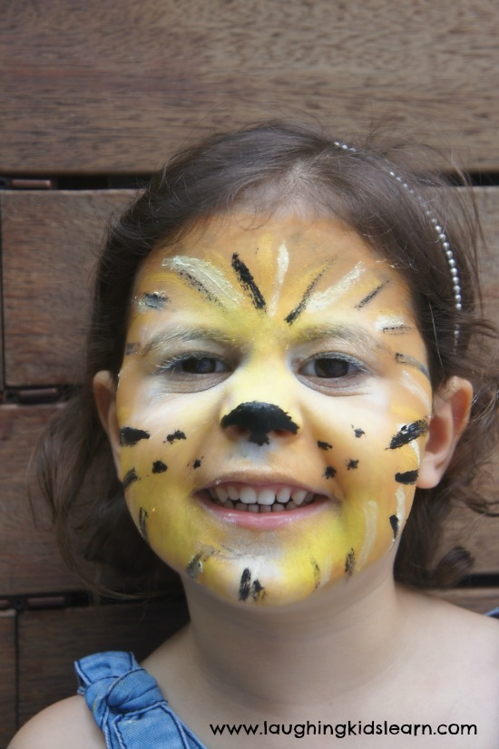 Simple face painting design of a lion   Laughing Kids Learn simple lion face painting