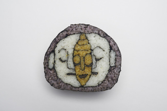 http://laughingsquid.com/smiling-sushi-roll-a-new-book-of-tama-chans-sushi-roll-art/
