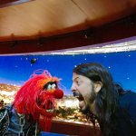 Dave Grohl of the Foo Fighters Challenges Animal of The Muppets To an Epic Drum Battle