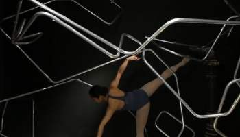 Faceless Dancers Use Trampoline to Rebound Onto a Rotating