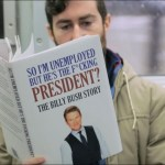 A Man Gets Curious Reactions as He Reads Fake Donald Trump Themed Books on the NYC Subway