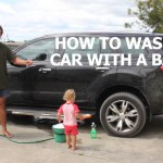 New Zealand Father Demonstrates How to Wash a Car With the Help of a Toddler