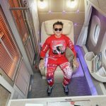 Casey Neistat Reviews the Emirates Airlines First Class Suite Wearing a Bright Red Sweatsuit
