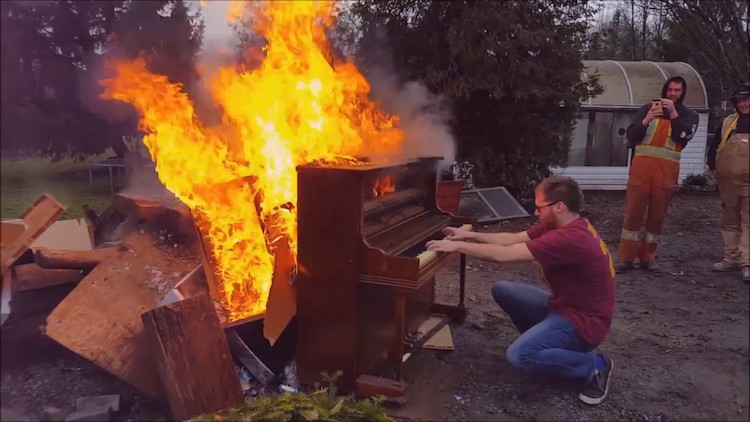 flaming-piano Talented Musician Plays a Medley of Jaunty Old Timey Tunes Upon a Burning Piano Random