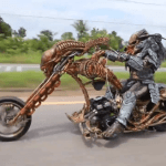 Motorcyclist Dressed as Predator Rides a Custom Alien Xenomorph Motorcycle in Thailand