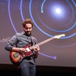 Guitar Playing Astrophysicist Explains How the Foundations of Music Are Correlated to the Universe