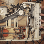 A Broken Vintage Piano Turned Into a Unique Analog Hybrid of 20 Instruments Connected to the Piano Keys