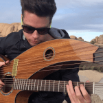 Musician Simultaneously Plays Lead, Rhythm and Bass of 'Another One Bites the Dust' on Harp Guitar