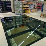 Dublin Grocery Store Installs Glass Floor So Customers Can View an 11th Century Home Located Underneath
