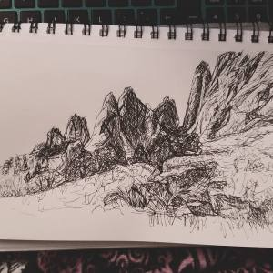 Sketchbook view of Garden of the Gods by Laura Jaen Smith. Black and white ink drawing of Colorado Springs rock formations.