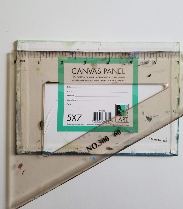 back of canvas with triangle ruler measuring length