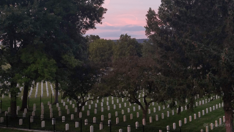 Photo of Woodlawn Cemetery National Cemetery in Elmira, NY at sunset with pink and blue sky by Laura Jaen Smith