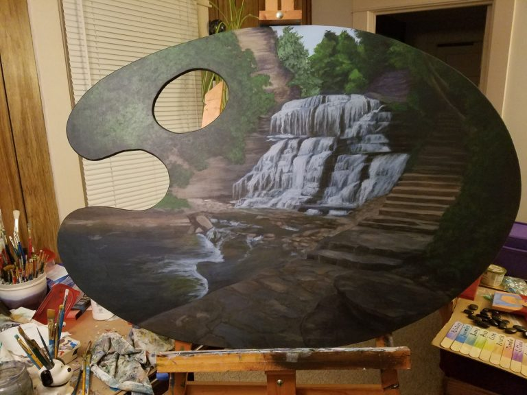 Escape to Paradise by Laura Jaen Smith. Giant palette-shaped acrylic painting of waterfall in Cascadilla Gorge Ithaca NY