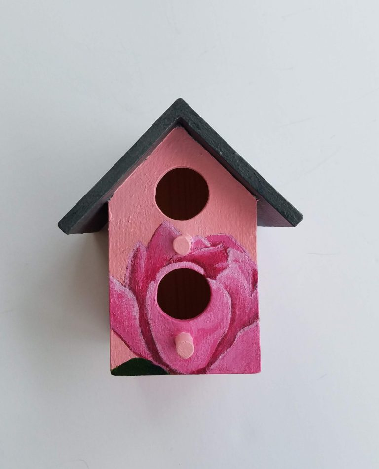 Pink Peony Birdhouse by Laura Jaen Smith. Small squared birdhouse with grey roof, hand-painted peonies with pink background on main body.