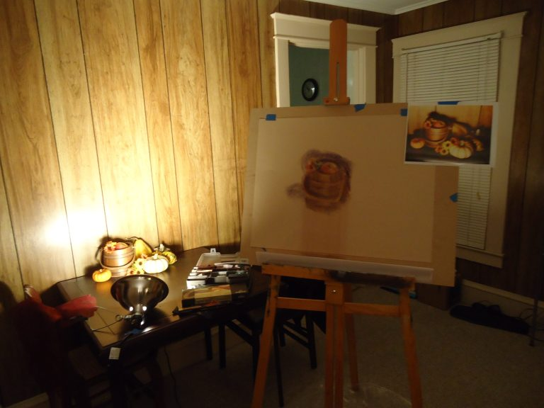 Studio of Laura Jaen Smith view of easel work in progress of pastel drawing of autumn still life of pumpkins and sunflowers.