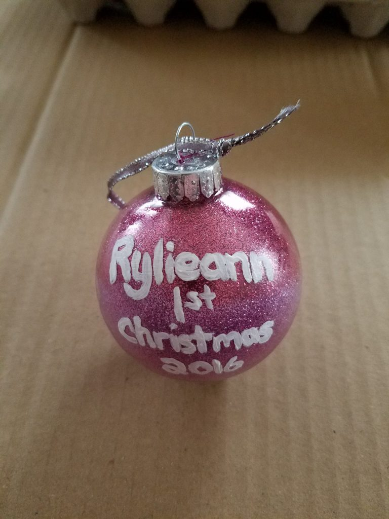 Pink ornament with white lettering - Rylieann 1st Christmas 2016